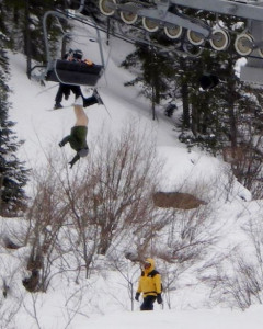 A man had a lucky escape but suffered a little more exposure than he would have wanted when he slipped through the back of a ski lift chair...He was left dangerously dangling upside down with his trousers and pants pulled down for all the world to see...It happened at the posh Vail resort in Colorado...It apparently occurred after the male skier and a child boarded a high-speed lift in Vail's Blue Sky Basin. It appears the chairlift's fold-down seat was somehow not in the lowered position, which caused the man to partially fall through the resulting gap. His right ski got jammed in the ascending chairlift, and that kept him upended since his boot never dislodged from its binding...As seen from photos taken by other skiers, the Skyline Express lift was stopped shortly after the pair's botched boarding resulted in the man dangling from the lift. The exposed skier was stuck for about 15 minutes before Vail personnel backed the lift up and successfully dislodged the unidentified man from the four-seat chair.